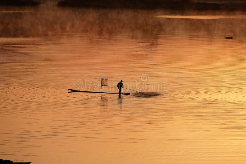 Fishermen working at sunrise royalty free stock photos