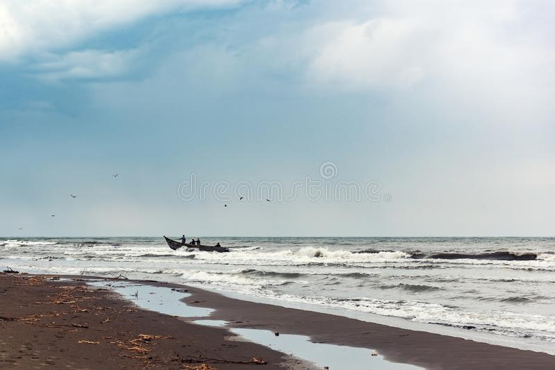 Fishermens on a boat in the sea. Fishing stock photography