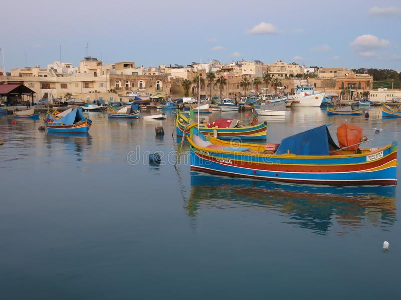 Fishermens boats in Marsaxlokk in Malta stock photo