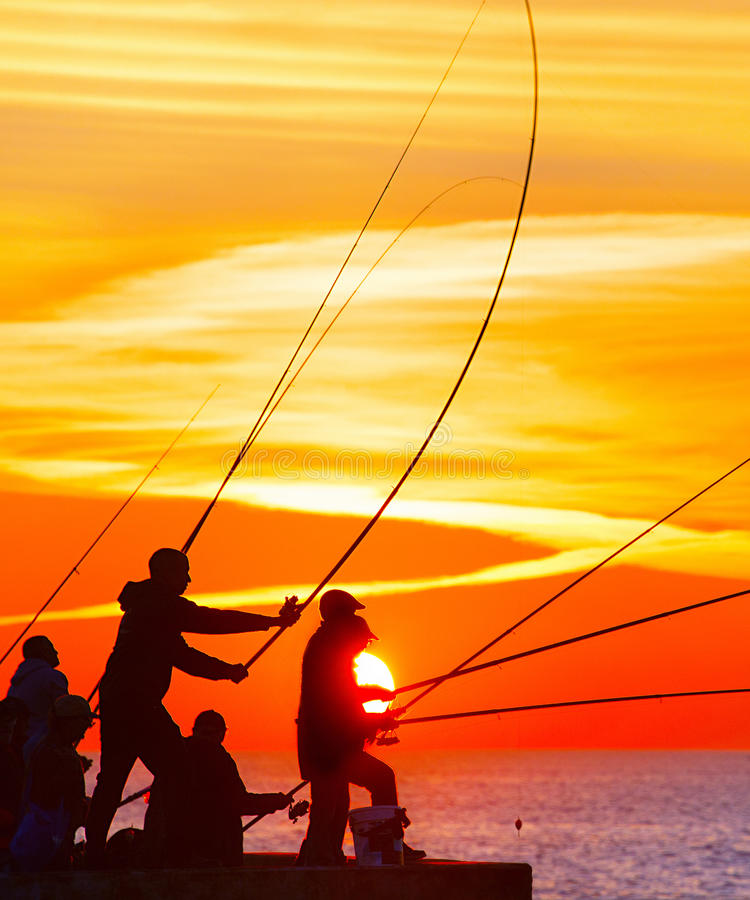 Fishers at beautiful sunset stock photography