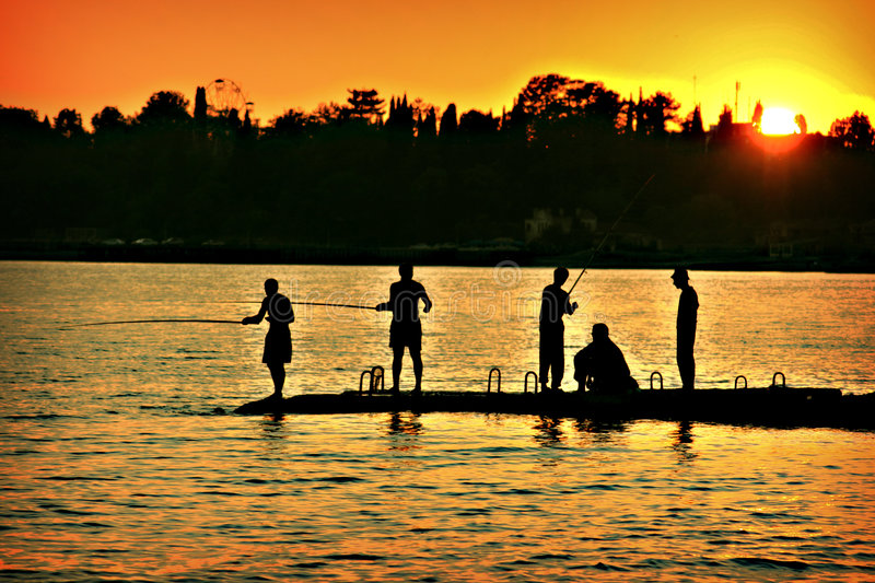 The fishers sunset royalty free stock photo