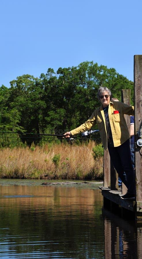 Fisherwoman Enjoys poranek nad jeziorem WFT zdjęcia royalty free