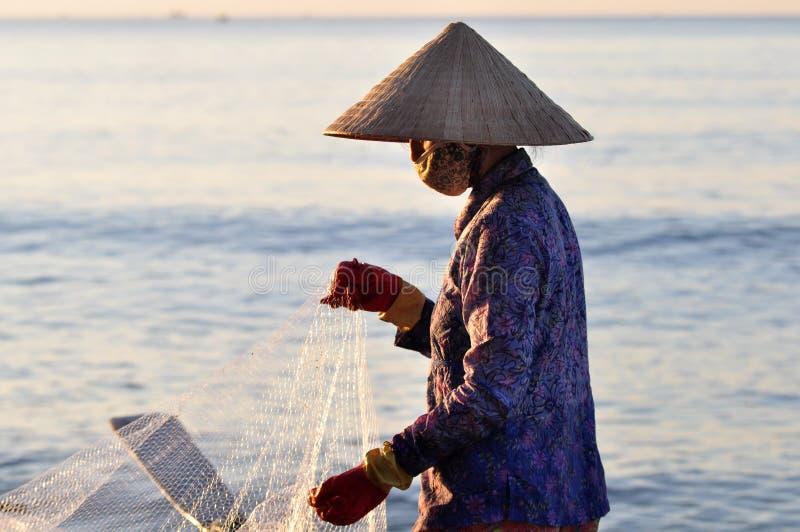 Fisherwoman in Vietnam stockbilder