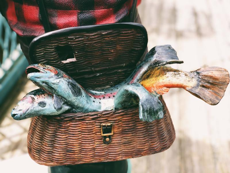 Fishes statue in a basket. On Old Drake Hill Flower Bridge by Farmington River in Simsbury, Connecticut,United States royalty free stock photography