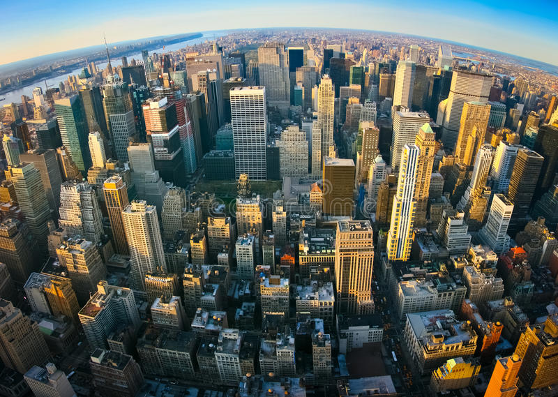 Fisheye aerial panoramic view over New York. Fisheye aerial panoramic view over upper Manhattan from Empire State building top, New York. Sunset of a clean stock photography