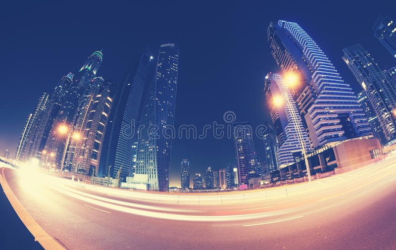 Fisheye lens picture of Dubai downtown at night, color toning ap royalty free stock image
