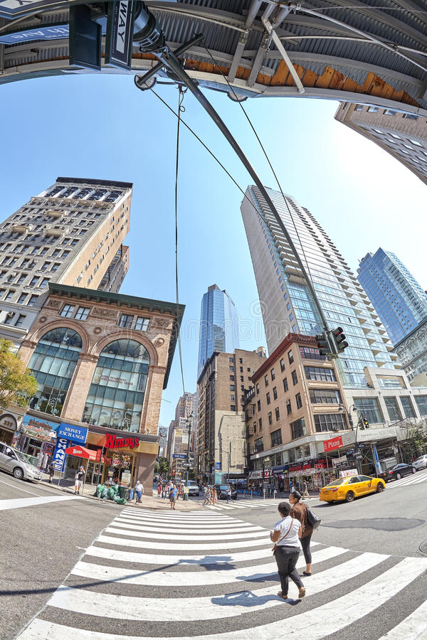 Fisheye lens picture of pedestrian crossing at busy Fifth Ave and East 33rd St corner. New York, USA - August 15, 2015: Fisheye lens picture of pedestrian stock photography