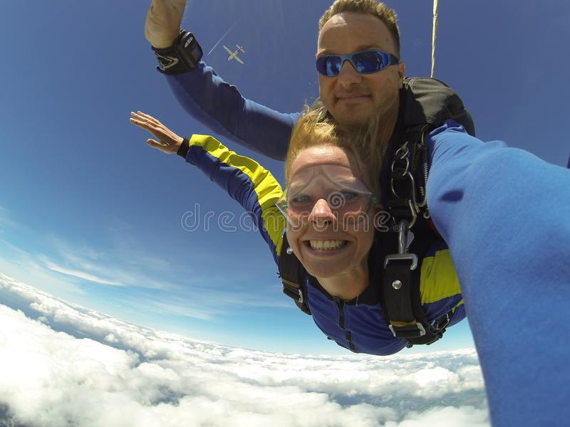 Fisheye Photography of Man and Woman Sky Diving stock photography