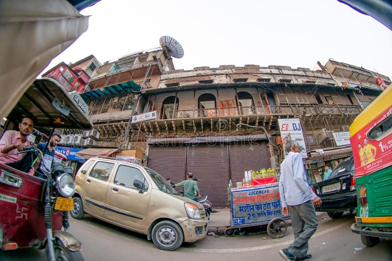 fisheye shot of chandni chowk with auto and electric rickshaw and old buildings royalty free stock images