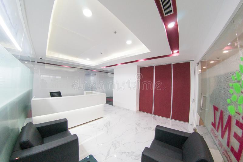 Fisheye shot of modern office with white walls and red inserts royalty free stock photos