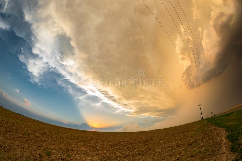 Fisheye view of beams of sunlight shining on the anvil of a severe Texas thunderstorm stock photo