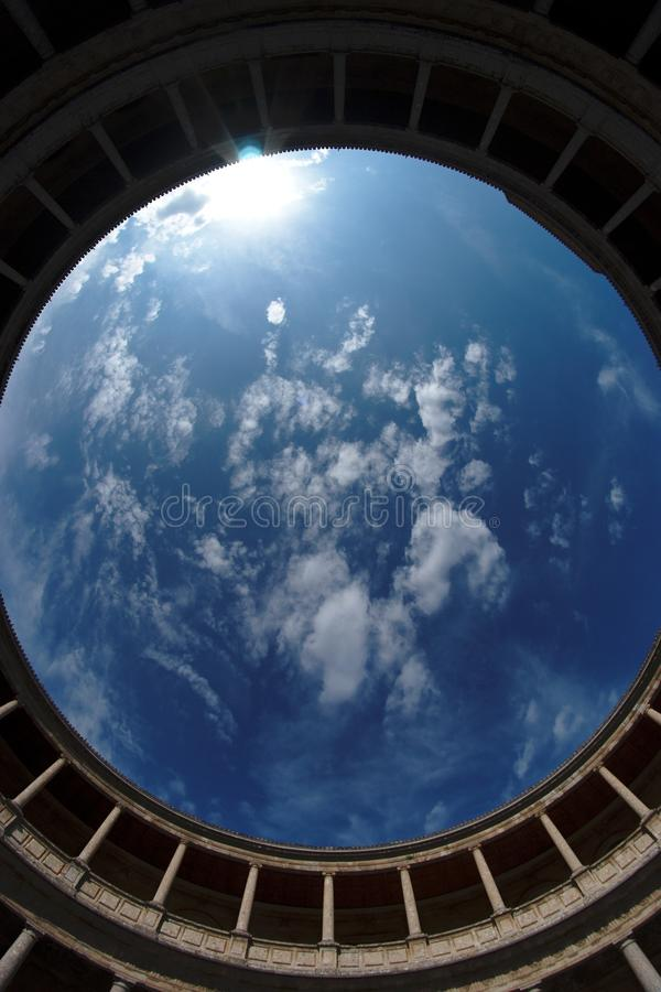 Fisheye view of sky above Palacio de Carlos V in G royalty free stock image