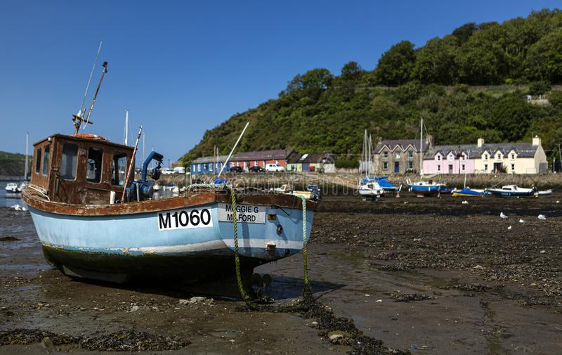 Fishguard, Pembrokeshire, Wales, UK. August 19, 2019. Picturesque small boats moored along the quayside at the harbour.  stock photo