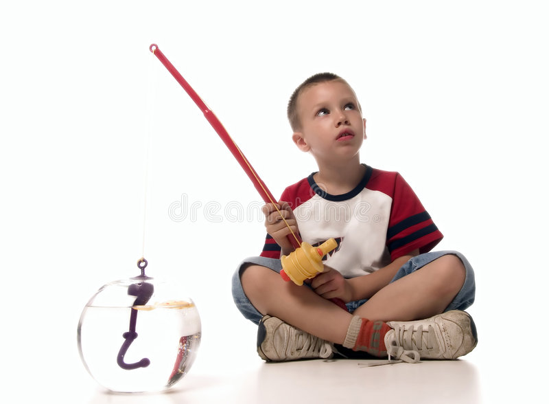 Fishing. Boy is fishing and waiting royalty free stock photography
