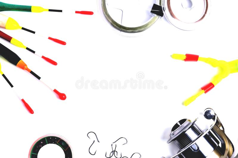Fishing accessories, accessory box, fishing reel, hooks, fishing line, floats on a white background, a place for copy space. Clouse up stock images