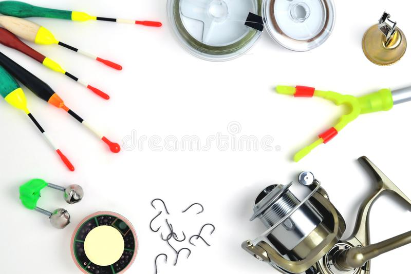 Fishing accessories, accessory box, fishing reel, hooks, fishing line, floats on a white background, a place for. Copy space stock photo