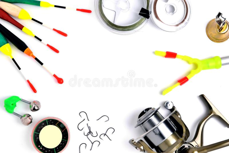 Fishing accessories, accessory box, fishing reel, hooks, fishing line, floats on a white background, a place for copy space. Close up royalty free stock photography