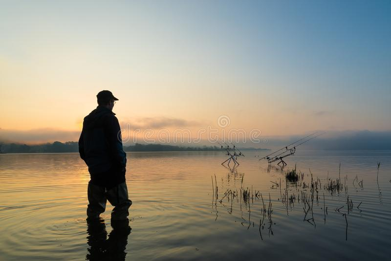 Fishing adventures, carp fishing at sunset. Active lifestyle concept stock photography