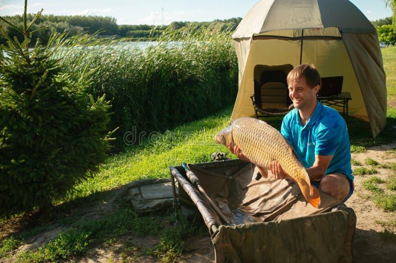 Fishing adventures, carp fishing royalty free stock images