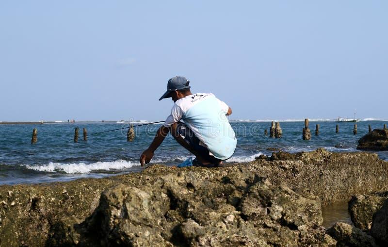 Fishing at Anyer Beach. Serang, Indonesia - May 24, 2019: Someone fishing at Anyer Beach in Serang, Banten royalty free stock photos
