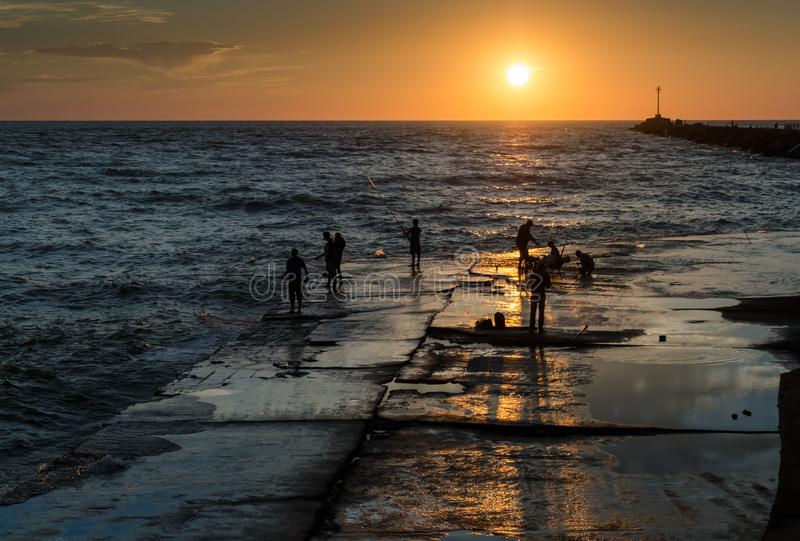 Fishing in Argentina. Locals fish on the city beach in Mar del Plata in Argentina stock images