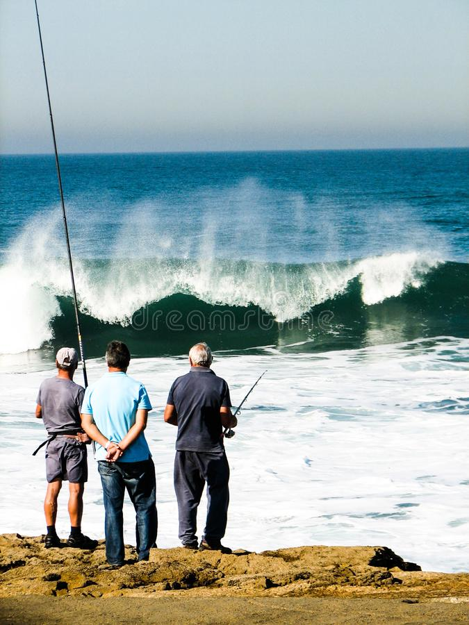 Fishing in the Atlantic waves stock photography