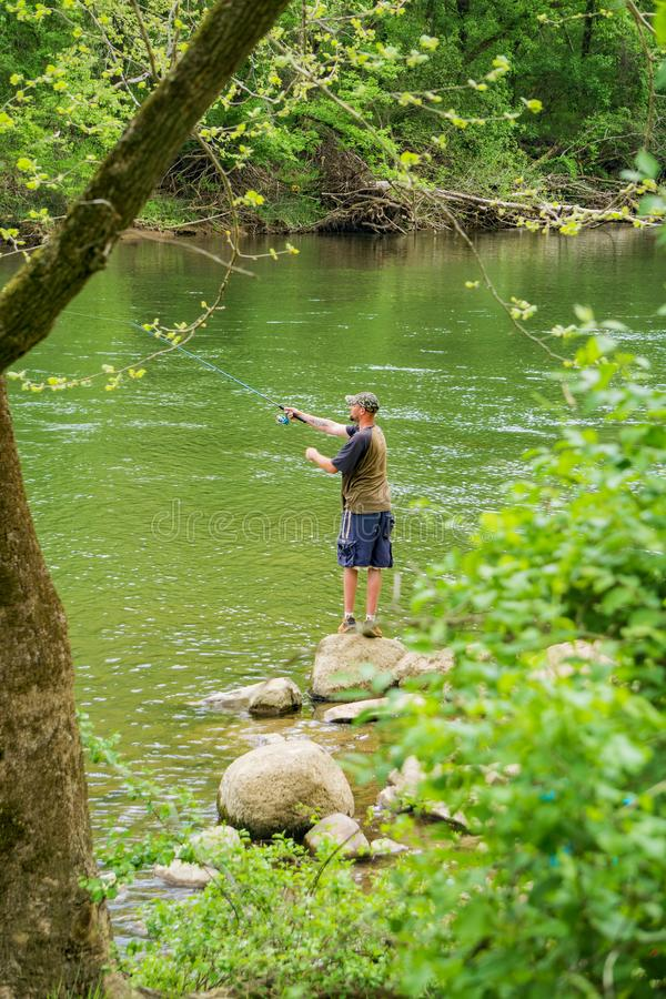 Fishing from the Banks of the Roanoke River stock images