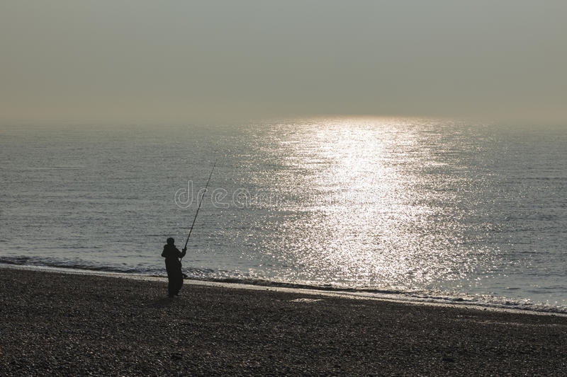 Fishing on the Beach royalty free stock photography