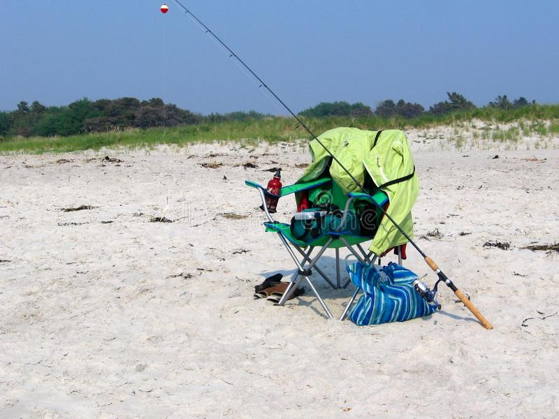 Fishing on the beach. stock image