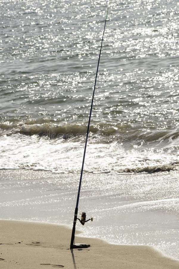 Fishing on beach, sea, ocean, alone, rod and tackle,day stock image