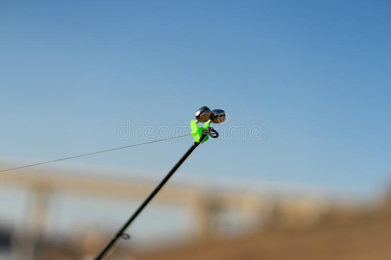 Fishing bell at the end of a fishing rod. Bells will ring when the fish is hooked. The tip of the fishing rod with the stock images