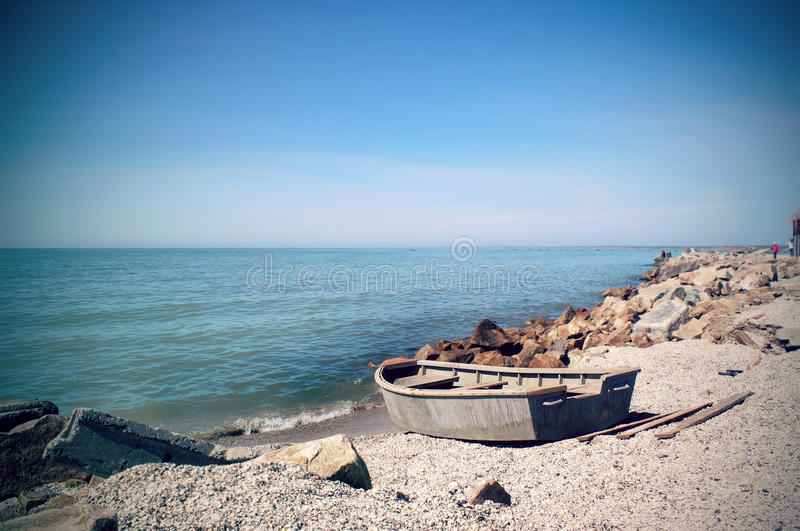 Fishing boat. On the beach royalty free stock photo