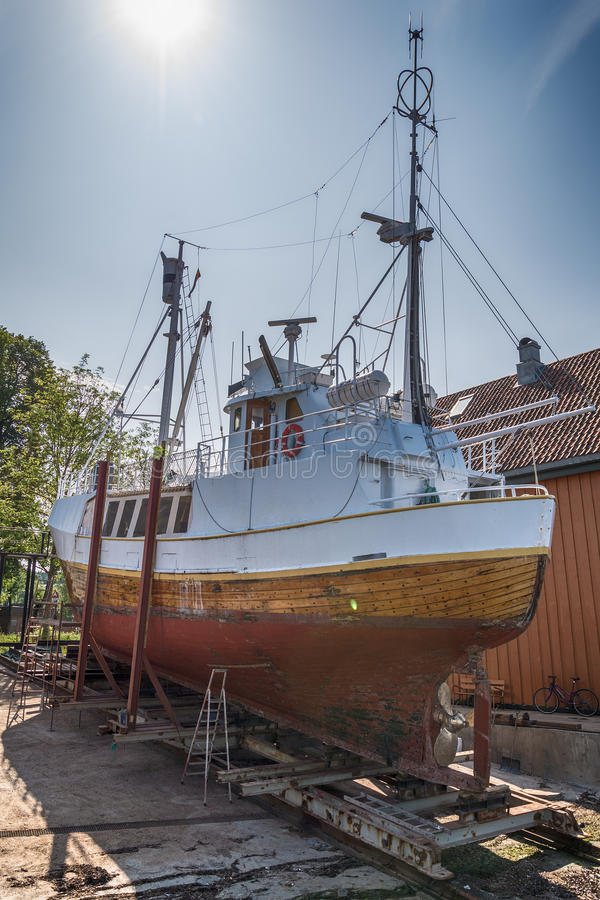 Fishing boat being repaired in Tonsberg, Norway. Fishing boat being repaired in Tonsberg, Norway stock images