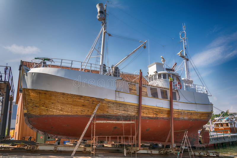 Fishing boat being repaired in Tonsberg, Norway. Fishing boat being repaired in Tonsberg, Norway royalty free stock images