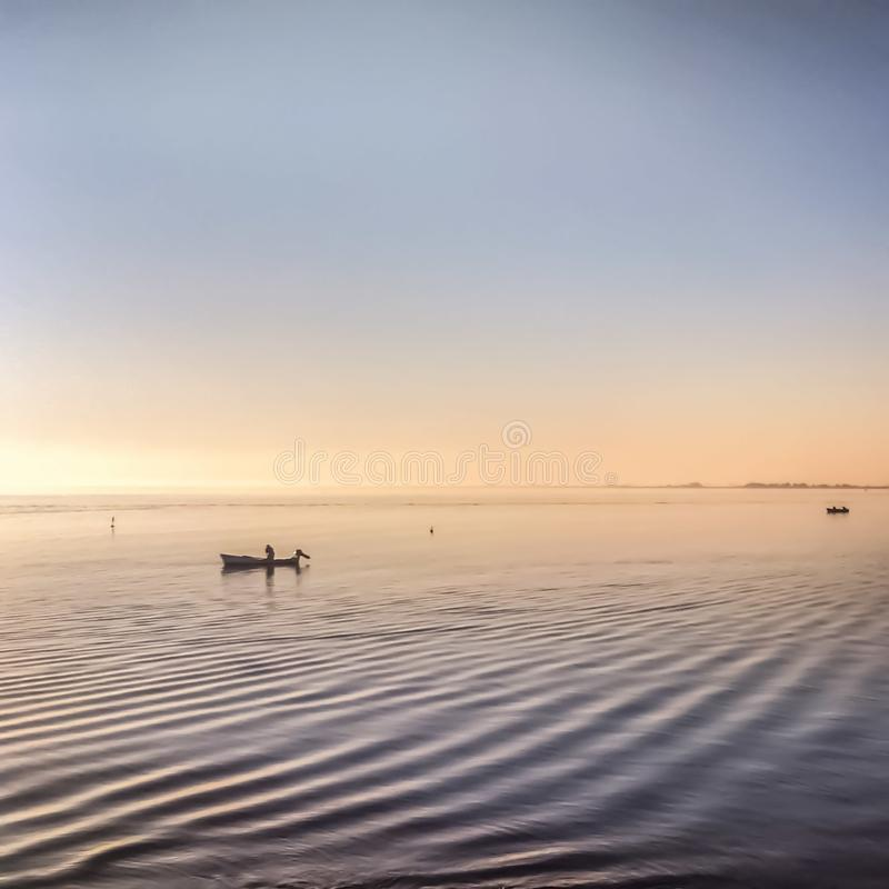 Fishing boat and calm sea royalty free stock photo