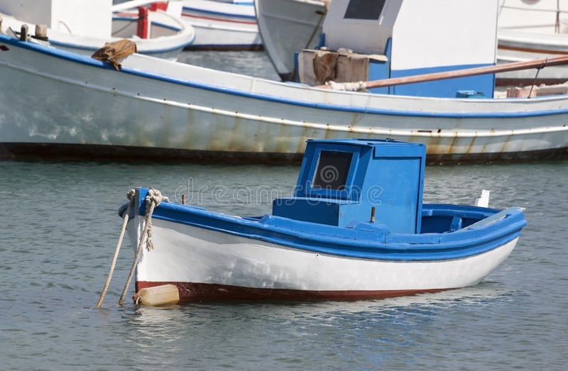 Fishing boat. Closeup of a traditional greek fishing boat on the port stock images