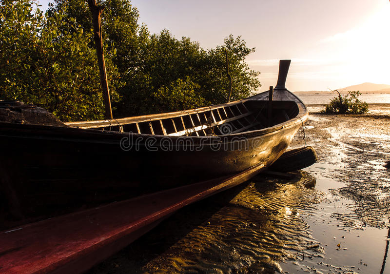 Fishing boat with color of sunset stock image