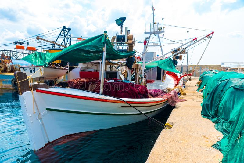 Fishing boat with colorful nets at the dock royalty free stock photo