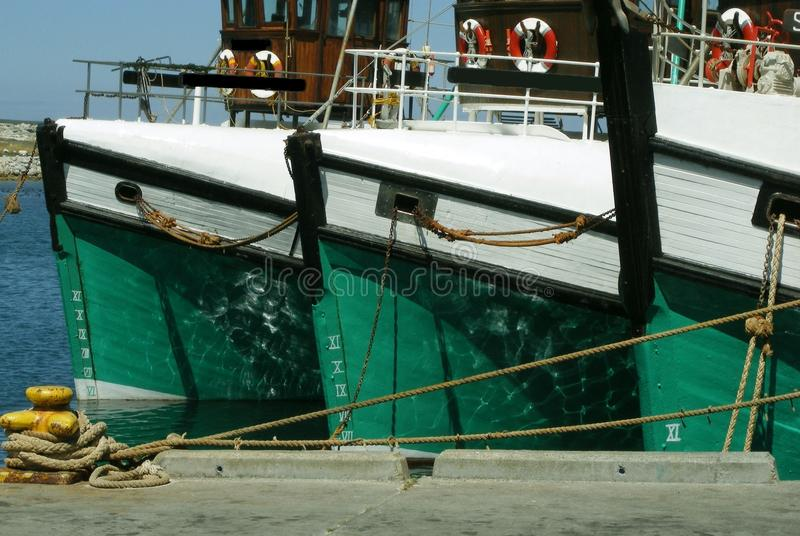 Fishing boat design. Three fishing boat bows aligned in Gansbaai harbour West coast of South Africa stock photo