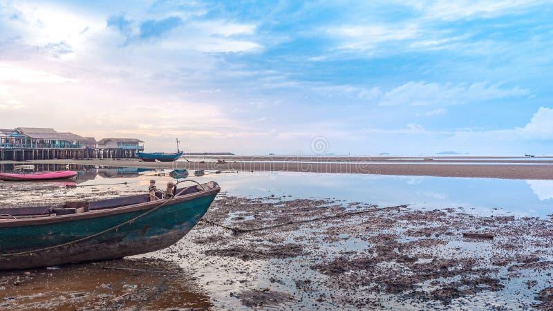 Fishing boat docking on the sand bars royalty free stock photo