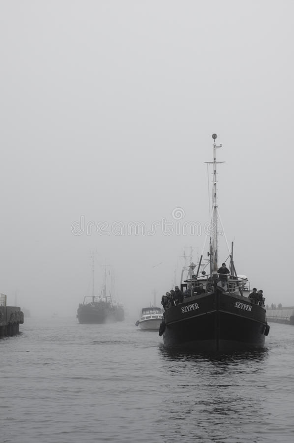 Fishing boat entering harbour royalty free stock images