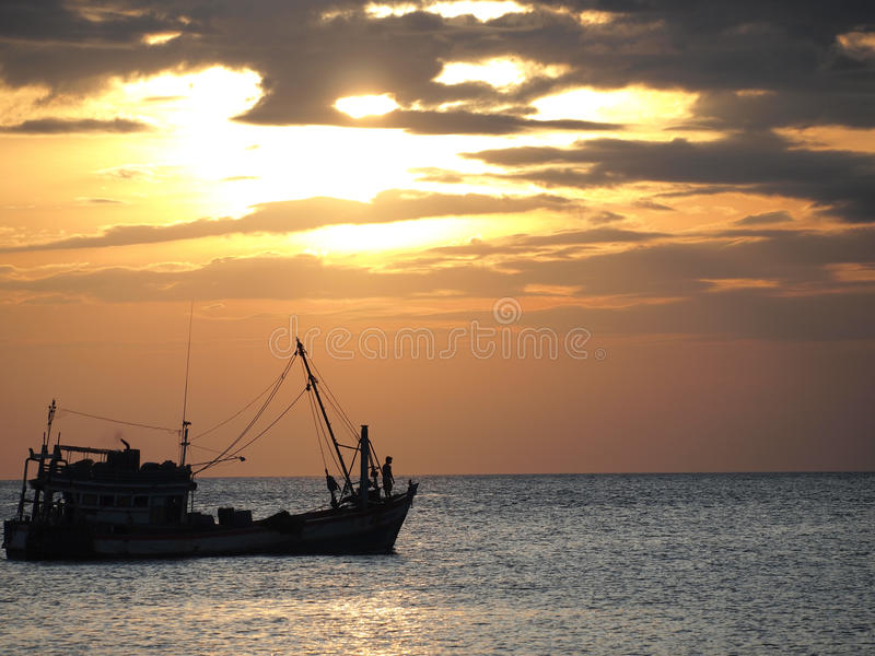 Fishing boat in the evening royalty free stock photo