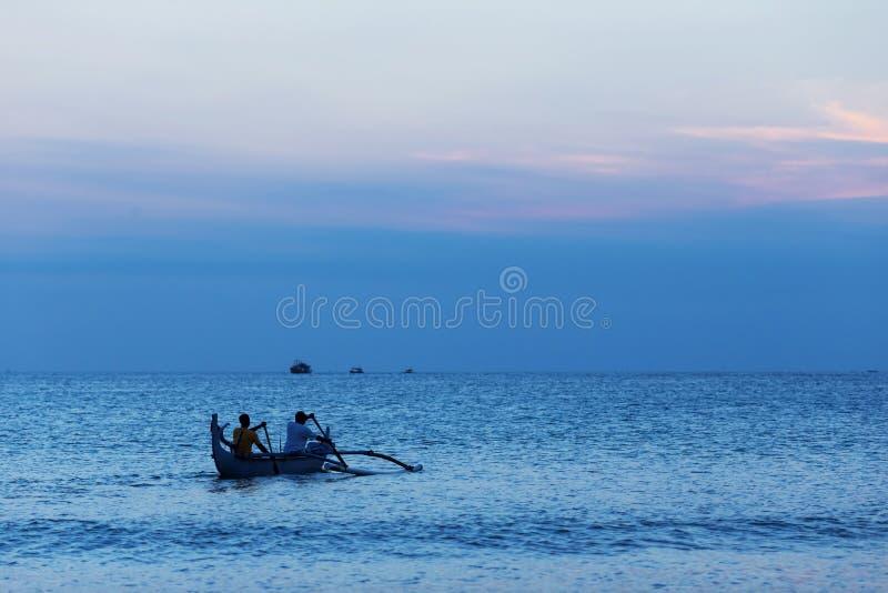 Fishing boat. Fishermen rowing a small fishing boat at sea,Langkawi island,Malaysia stock photo