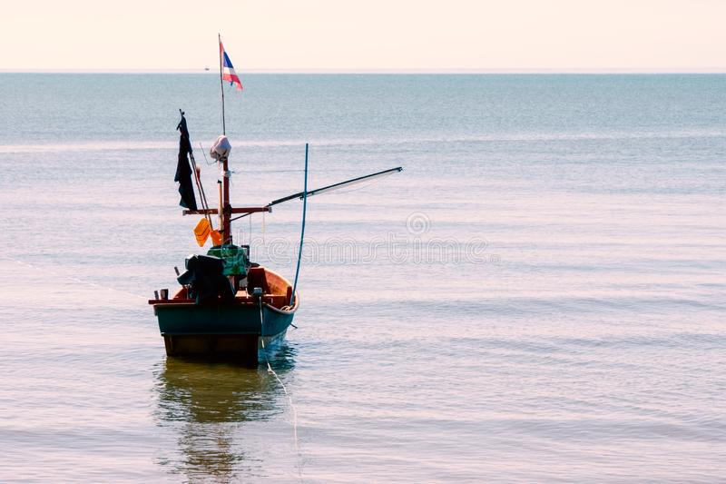 Fishing boat floating on peaceful sea in Thailand. Fishing boat floating on peaceful sea waiting time to go fsihing stock photo
