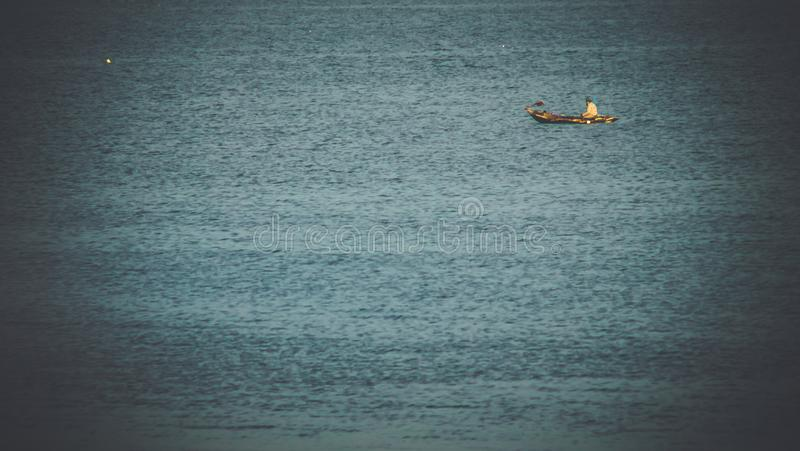 Fishing boat floating in the sea.beautiful turquoise stock photos