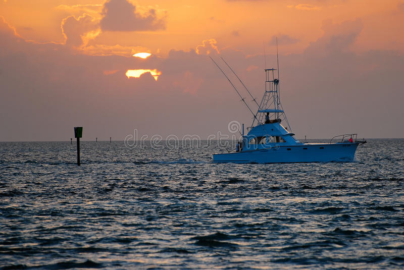 Fishing boat florida sunrise. A charter boat leaving the dock for a day of offshore fishing just off the Florida coast royalty free stock photography