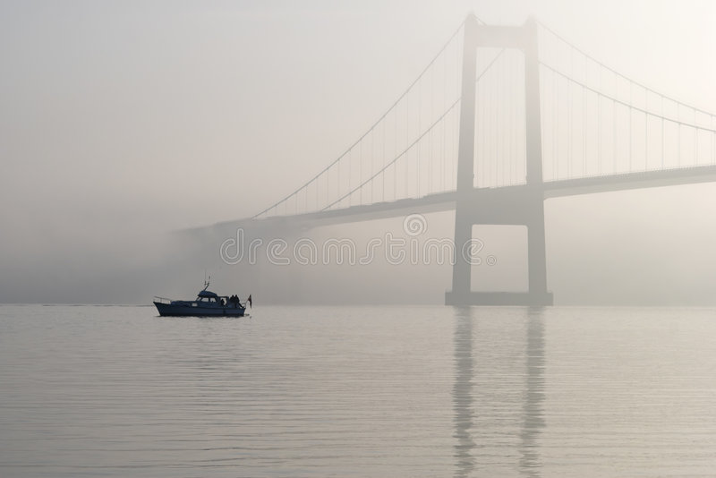 Fishing from boat a foggy day royalty free stock photography