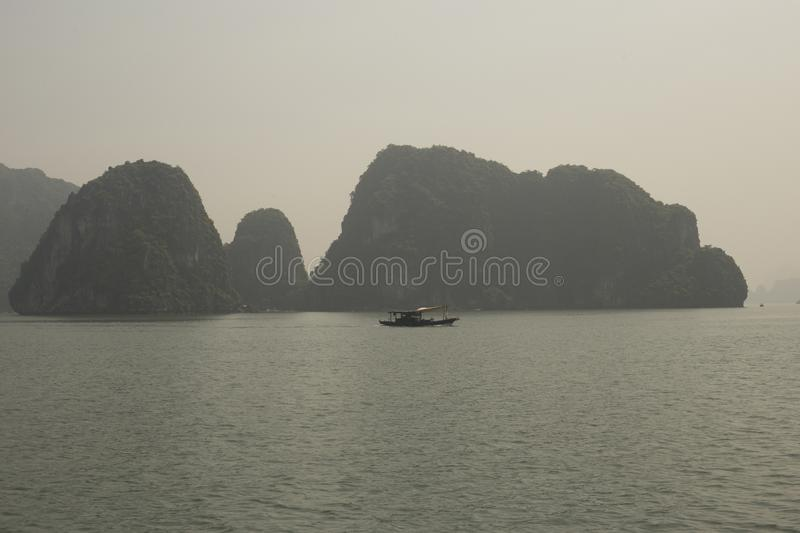Fishing boat in Halong Bay at sunset royalty free stock images