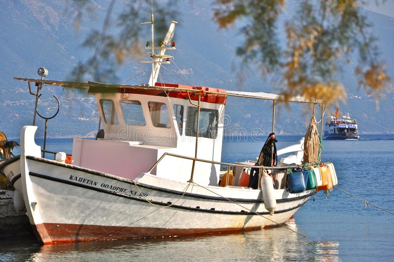 Fishing boat in the harbour of Fiskardo village, Kefalonia, Ionian islands, Greece. stock photos