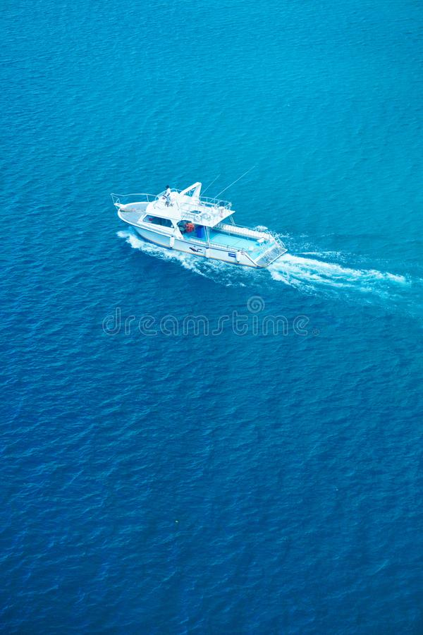 Fishing Boat at High Speed. An aerial view of a fishing boat going at high speed in the ocean royalty free stock images